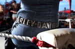 A biker watches the festivities during Champion Midget Wrestling Suck Bang Blow biker bar, in Murrells Inlet, South Carolina, May 19, 2012.  The show was one of the events held during the annual Harley-Davidson Motorcycle Spring Rally in and around Myrtle Beach. Picture taken May 19, 2012.  REUTERS/Randall Hill