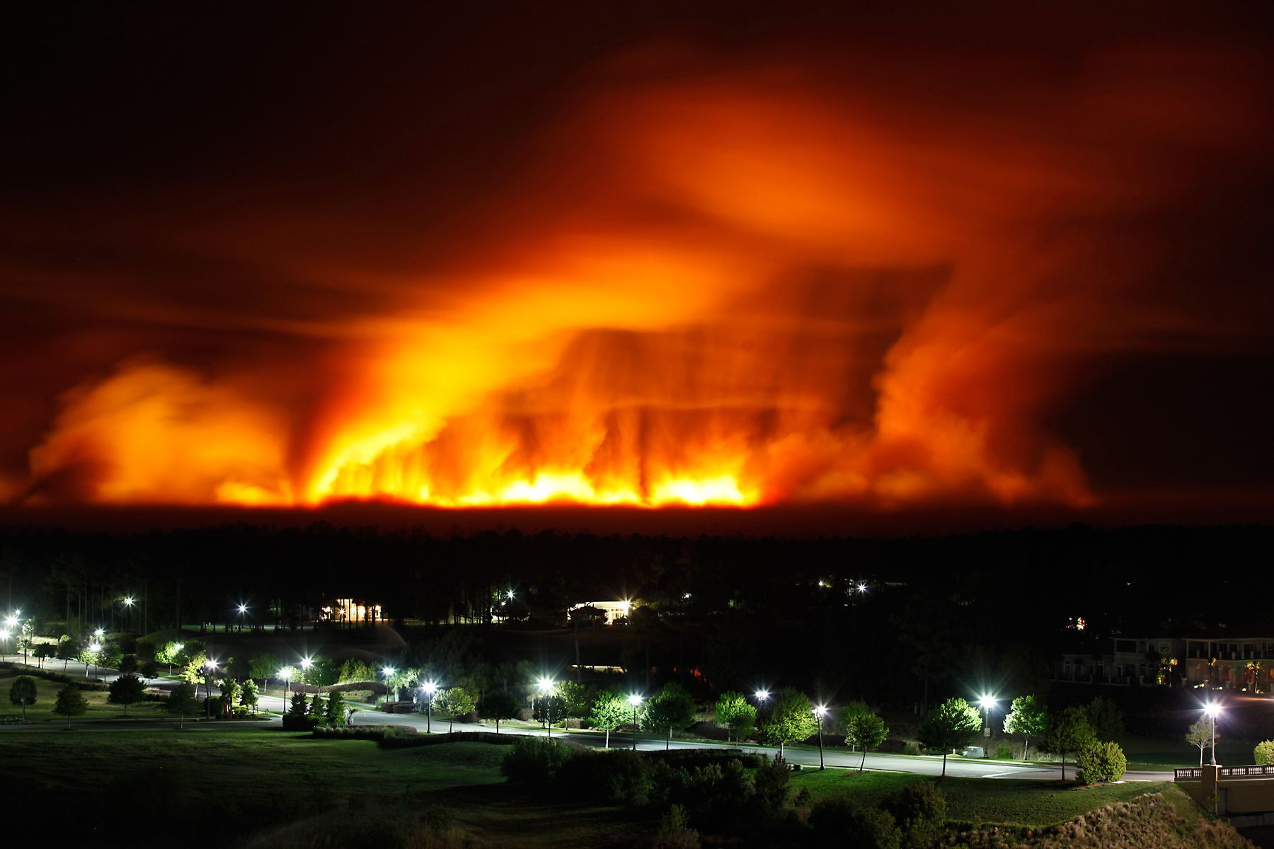 Taken from the top floor of the Marina Inn at Grande Dunes, a wild fire glows the sky red near the upscale development in Myrtle Beach. The wild fire destroyed more than 70 homes in nearby North Myrtle Beach.
