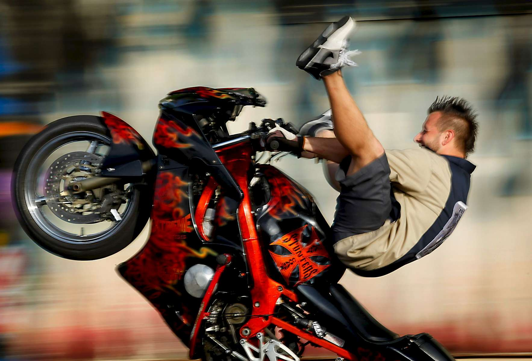 Kelly Joe Andrews, a rider with East Coast Stunters, performs during the group's Friday night performance at The Dog House, North during the Crusinin The Coast Spring Rally along the Grand Strand.