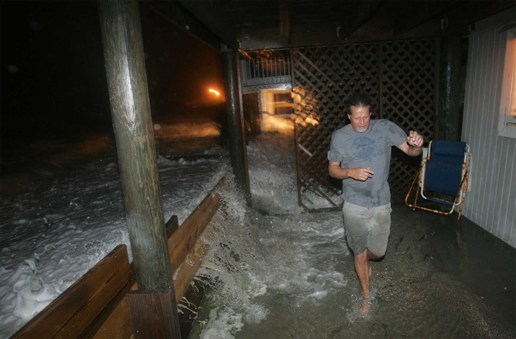 Gordon Roberts of Ocean Isle Beach runs from a storm surge at his home on East Third Street on September 5, 2008, during the effects of tropical storm Hanna in Ocean Isle Beach. Because of ongoing beach erosion problems, many east end residents fear tropical storm Hanna could cause severe damage to area homes if it hits at high tide.