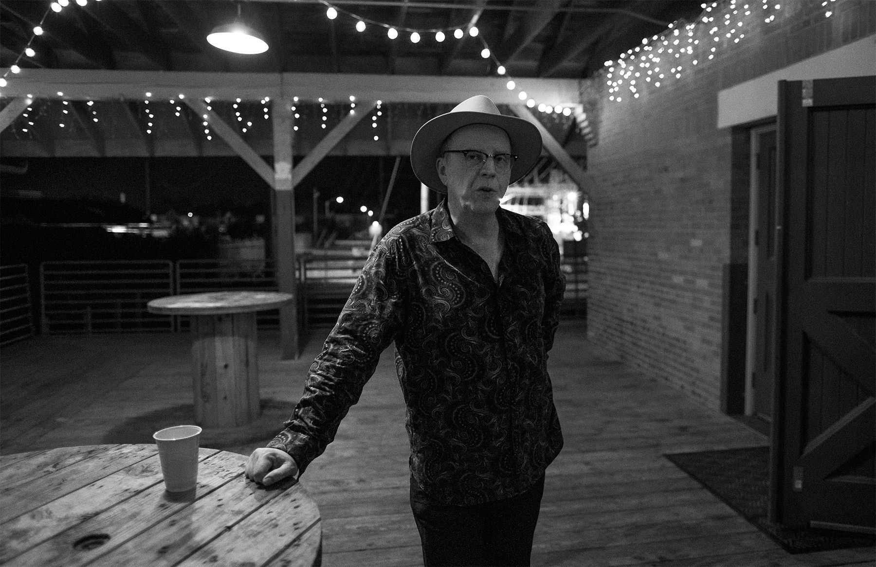 Webb Wilder relaxes outside after his performance at The Historic Myrtle Beach Train Depot on March 12, 2016. It was Webb's second appearance at the SXSE music series. Webb describes his music this way. {quote}Rock 'n' roll, from Nashville. Formed from Mississippi mud, tinged with British mod. Bruised by the blues. Baptized by Buck and Chuck. Psychiatric psycho-rootsy. Sizzling, glistening, uneasy listening.{quote}
