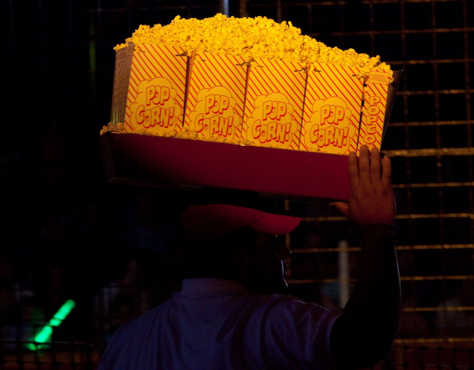 A vendor sells popcorn to the patrons of the Cole Brothers Circus of the Stars in Myrtle Beach, South Carolina March 31, 2013. Traveling circuses such as the Cole Brothers Circus of the Stars, complete with it's traveling big top tent, set up their tent city in smaller markets all along the East Coast of the United States as they aim to bring the circus to rural areas. The Cole Brothers Circus, now in its 129th edition, travels to 100 cities in 20-25 states and stages 250 shows a year.   REUTERS/Randall Hill   (UNITED STATES)