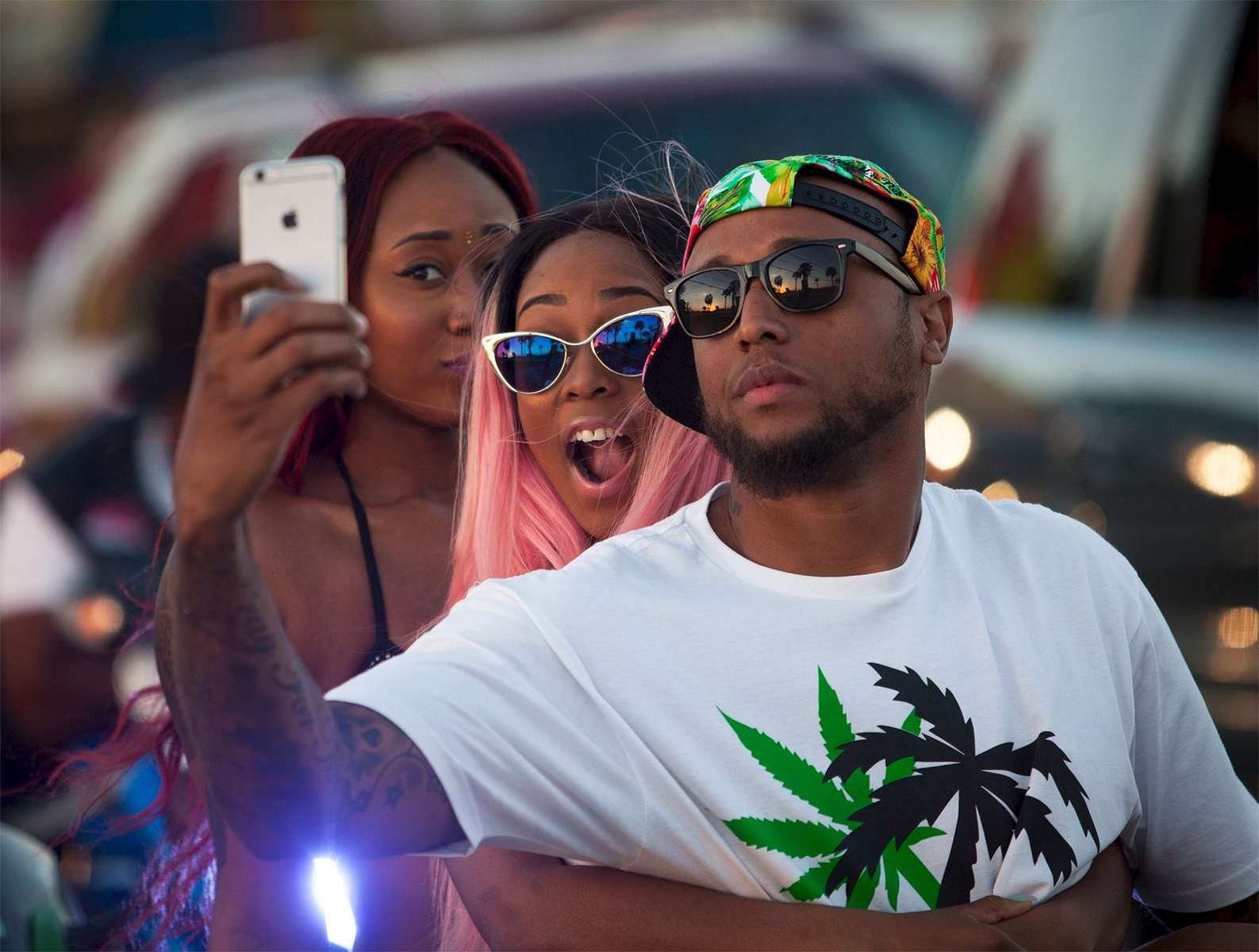 Festival goers take a group selfie while waiting in traffic on Ocean Boulevard during the 2015 Atlantic Beach Memorial Day BikeFest in Myrtle Beach, South Carolina May 24, 2015. After three people were killed and seven wounded in shootings during 2014 Bikefest, State officials called for an end to the event that draws thousands to the family-friendly beach town. Their efforts were unsuccessful. Bikers returned to Myrtle Beach - just a week after a bloody motorcycle gang shootout in Waco, Texas. But this time authorities are more prepared, with dozens of new surveillance cameras and a police force three times the size of last year's. REUTERS/Randall Hill