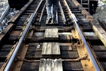 Conductor Jerry Stevens walks the foot path while checking the connections of the Waccamaw River Swing Bridge before a train's crossing to Myrtle Beach. The Conway Southern Railroad is the only trainline in the Grand Strand.