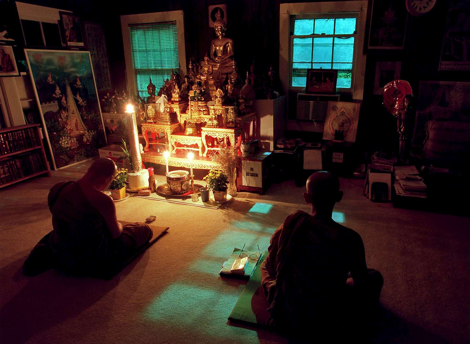 Abbott Phrakru Buddhamonpricha (L) and monk Bun Reang Reangsisai meditate at the Wat Carolina on Saturday night in September. The monks at the temple meditate and chant twice a day. Morning meditation starts at 8AM and evening meditation is at 8PM.