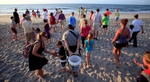 Tourists walk to the surf after watching an inventory of a hatched nest at Myrtle Beach State Park in Myrtle Beach, South Carolina August 4, 2012.REUTERS/Randall Hill
