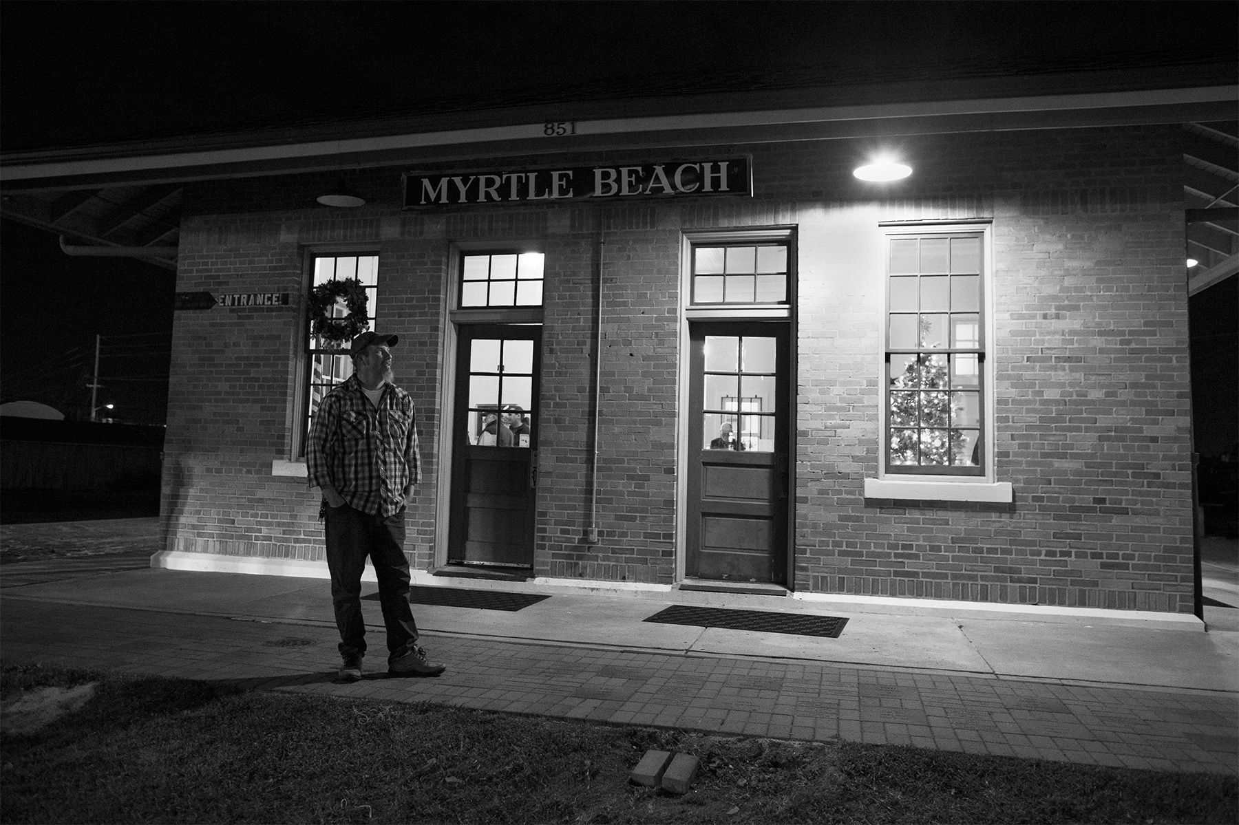 After sound check at the SXSE show on Saturday December 3, 2016, current SXSE president Seth Funderburk takes a break outside the Historic Myrtle Beach Train Depot before the Randall Bramblett show.