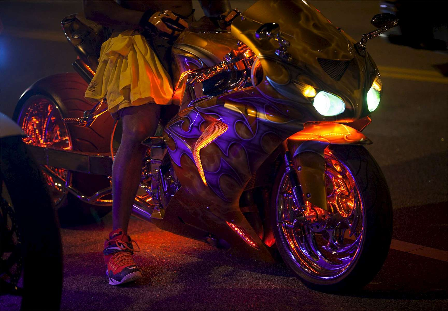 A customized sport bike is lit in neon lights as it's driver waits in traffic on Ocean Boulevard during the 2015 Atlantic Beach Memorial Day BikeFest in Myrtle Beach, South Carolina May 24, 2015. After three people were killed and seven wounded in shootings during 2014 Bikefest, State officials called for an end to the event that draws thousands to the family-friendly beach town. Their efforts were unsuccessful. Bikers returned to Myrtle Beach - just a week after a bloody motorcycle gang shootout in Waco, Texas. But this time authorities are more prepared, with dozens of new surveillance cameras and a police force three times the size of last year's. REUTERS/Randall Hill