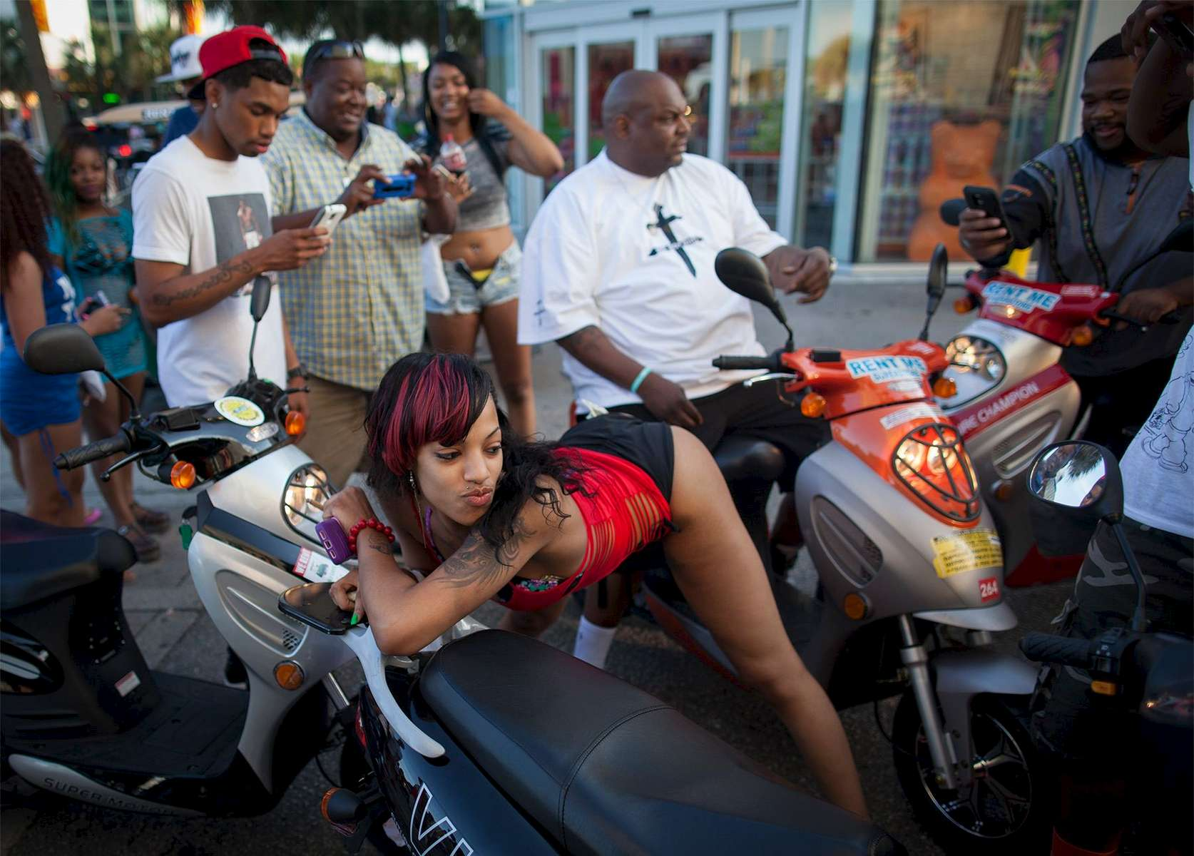 Brandy Shelton of Greensboro, North Carolina twerks for a group of bikers on Ocean Boulevard during the 2015 Atlantic Beach Memorial Day BikeFest in Myrtle Beach, South Carolina May 22, 2015. After three people were killed and seven wounded in shootings during 2014 Bikefest, State officials called for an end to the event that draws thousands to the family-friendly beach town.Their efforts were unsuccessful. Bikers returned to Myrtle Beach - just a week after a bloody motorcycle gang shootout in Waco, Texas. But this time authorities are more prepared, with dozens of new surveillance cameras and a police force three times the size of last year's.    REUTERS/Randall Hill