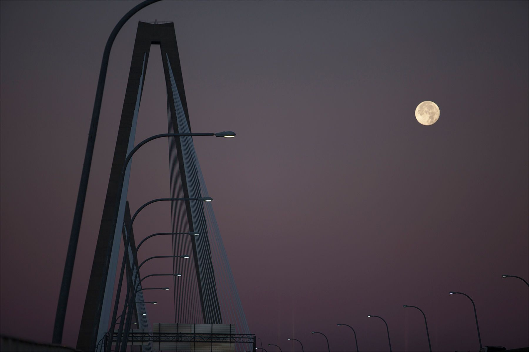 The moon sets over the Arthur Ravenel Jr. Bridge that leads into Charleston, South Carolina on December 18, 2013. Finished in 2005, the bridge has quickly become an iconic image for the historical city. Charleston with a non-union labor force, business friendly government and heavy tax incentives, are luring companies like Boeing to South Carolina. It also helps with Charleston's reputation as a top tourist destinations and a place rich in history and culture. For the third consecutive year, Charleston's been voted the No. 1 city in the United States by Condé Nast Traveler. REUTERS/Randall Hill   (UNITED STATES)