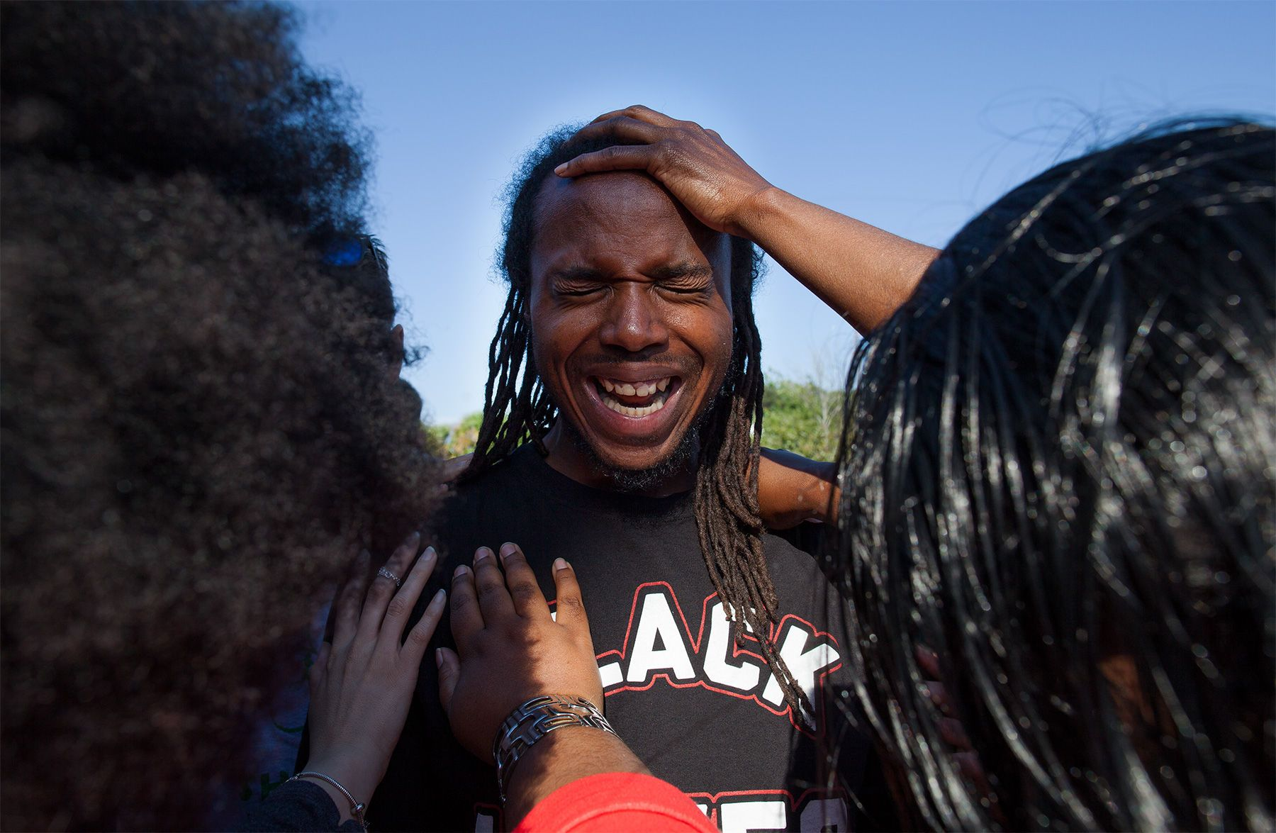 Muhiyidin Moye D'Baha of the Black Lives Matter movement, leads his group in prayer before a press conference demanding a citizen review board in North Charleston, South Carolina April 9, 2015. For the dozens of protesters who descended on the working-class South Carolina city of North Charleston on Wednesday, a bystander's video of a white police officer gunning down Scott was long-awaited confirmation of what many residents have been saying for years. Activists said the footage, showing Officer Michael Slager shooting 50-year-old Walter Scott in the back, is chilling evidence of what they portray as {quote}an atmosphere of racism{quote} that allows African-Americans to be targeted in North Charleston and across the state.  REUTERS/Randall Hill
