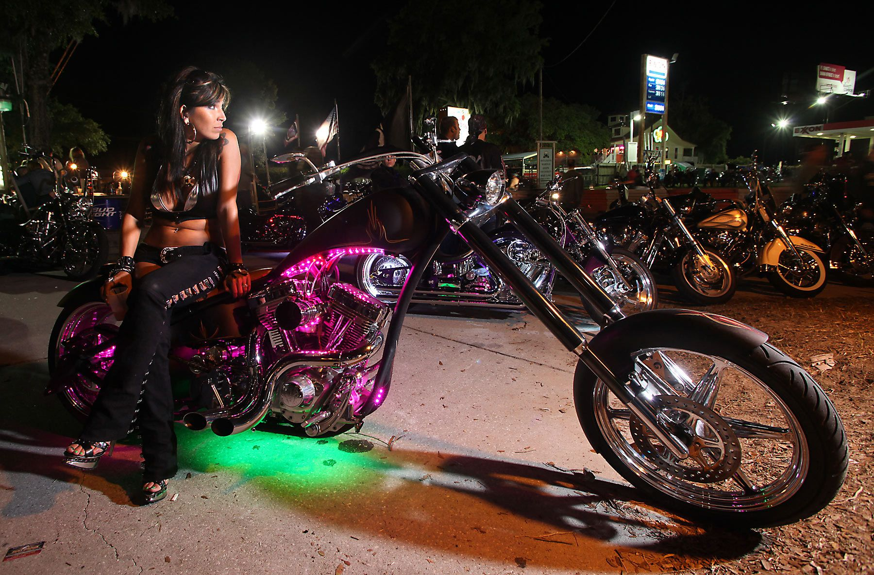 Christina Davie of Christiansburg, Va., waits outside the biker bar Suck Bang Blow in Murrells Inlet, South Carolina, May 19, 2012, during the annual Harley-Davidson Motorcycle Spring Rally in and around Myrtle Beach. Picture taken May 19, 2012.  REUTERS/Randall Hill