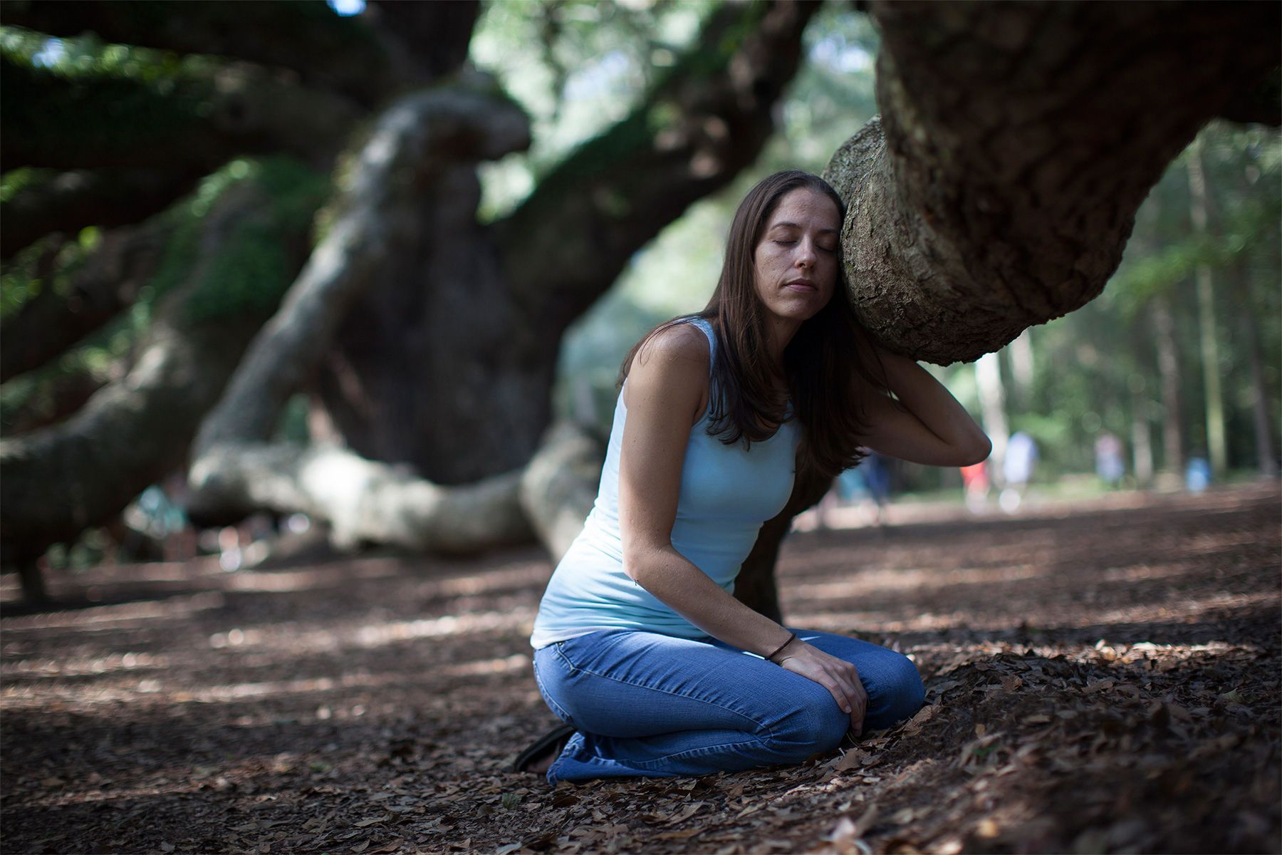 Samantha Siegel, 31, organizer behind the grass roots Save the Angel Oak petition, poses in front of the Angel Oak tree in Charleston, South Carolina September 24, 2013. {quote}I've always credited the tree to saving me,{quote} said the self-proclaimed tree hugger. {quote}Now it was my time to help save the tree.{quote} Charleston's urban forester Danny Burbage believes the tree to be 400 to 500 years old and one of the oldest living things east of the Mississippi River.  REUTERS/Randall Hill  (UNITED STATES)