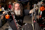 A biker known as Wild Bill parks his bike at Suck Bang Blow biker bar, in Murrells Inlet, South Carolina, May 19, 2012  during the annual Harley-Davidson Motorcycle Spring Rally in and around Myrtle Beach.  Picture taken May 19, 2012.  REUTERS/Randall Hill