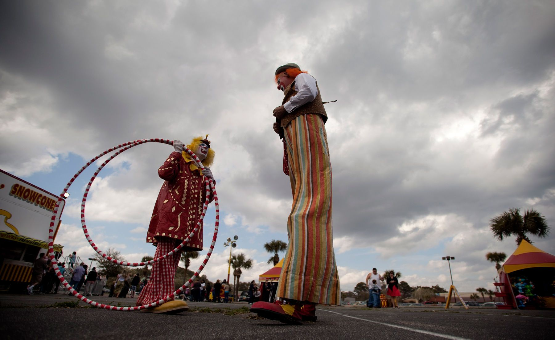 Josh Dummitt (center) as Meatball the clown and Julius Carallo as Clown Chips, prepare for the Cole Brothers Circus of the Stars show in Myrtle Beach, South Carolina March 31, 2013. Traveling circuses such as the Cole Brothers Circus of the Stars, complete with it's traveling big top tent, set up their tent city in smaller markets all along the East Coast of the United States as they aim to bring the circus to rural areas. The Cole Brothers Circus, now in its 129th edition, travels to 100 cities in 20-25 states and stages 250 shows a year.    For Reuters