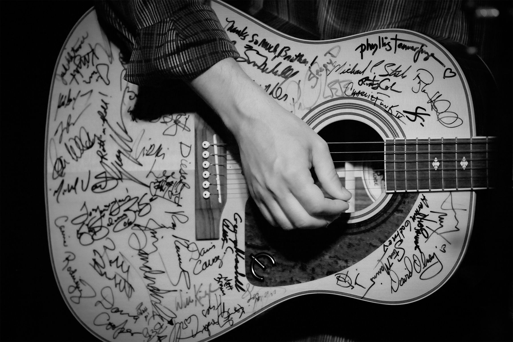 Lousiana songwriter Kevin Gordon performs with the {quote}SXSE Guitar{quote} at the Fest on August 14, 2010. The guitar has been signed by many of the musicians that have performed at the series.