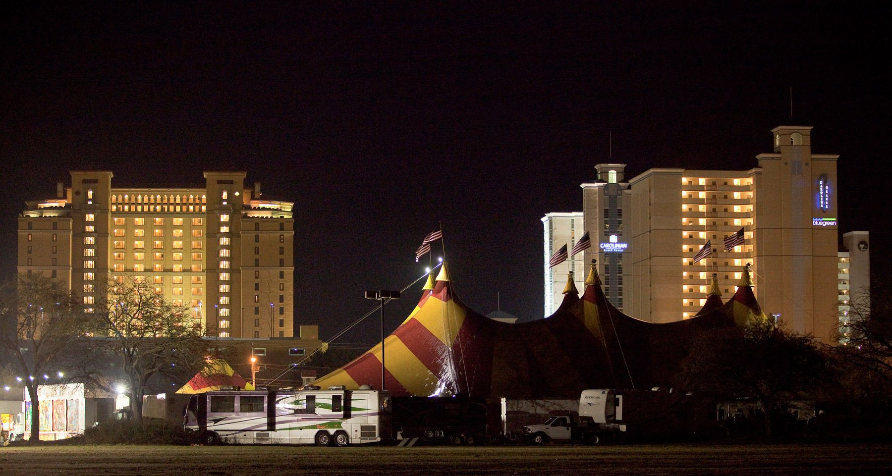 Cole Brothers Circus of the Stars tent city is staged with a backdrop of ocean resorts in Myrtle Beach, South Carolina March 31, 2013. Traveling circuses such as the Cole Brothers Circus of the Stars, complete with it's traveling big top tent, set up their tent city in smaller markets all along the East Coast of the United States as they aim to bring the circus to rural areas. The Cole Brothers Circus, now in its 129th edition, travels to 100 cities in 20-25 states and stages 250 shows a year. For Reuters