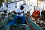 Arthur Linden uses a johnboat to survey the flooded areas of his brother's property along Dunbar Road in Georgetown, South Carolina October 8, 2015. Flooding from historic rainfall in South Carolina claimed two more lives on Wednesday, and the threat of further inundation from swollen rivers and vulnerable dams put already ravaged communities on edge.  REUTERS/Randall Hill