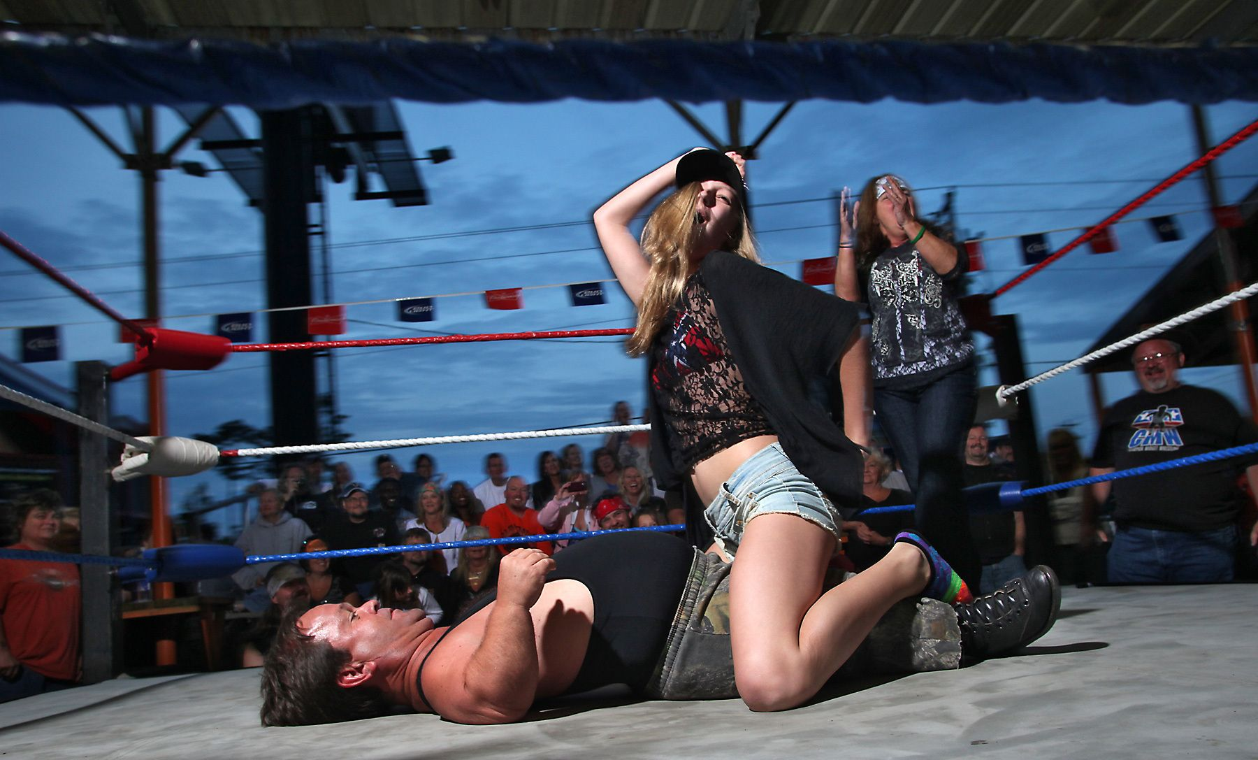 A woman competes in a competition with midget wrestler Joe Kidd  May 19, 2012 at the biker bar Suck Bang Blow in Murrells Inlet, S.C.  The midget troupe of wrestlers performed nightly during the annual Harley-Davidson Motorcycle Spring Rally around Myrtle Beach, SC. Several motorcycle rallies are annual events in and around the southern resort community of Myrtle Beach. Later this week events starts for the Atlantic Beach Bike Fest in nearby Atlantic Beach.  Picture taken May 19, 2012.  REUTERS/Randall Hill