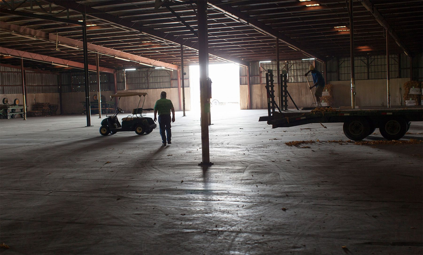 A day before the markets open, workers prepare the Big L Warehouse for opening in Mullins, South Carolina July 26, 2013. The warehouse is co-owned by Shelly but leased to the US Tobacco Cooperative during harvest. The cooperative sets the standard for pricing and quality of the farmer's crop. The traditional tobacco harvest requires many labor intensive hours to bring the crop to market, especially with the flue-cured variety prominent in the southern United States. With the growing health concerns with smoking in the US, most farmers use market cooperatives to sell their crop to the growing markets in China.      Picture taken on July 26, 2013.   REUTERS/Randall Hill (UNITED STATES)