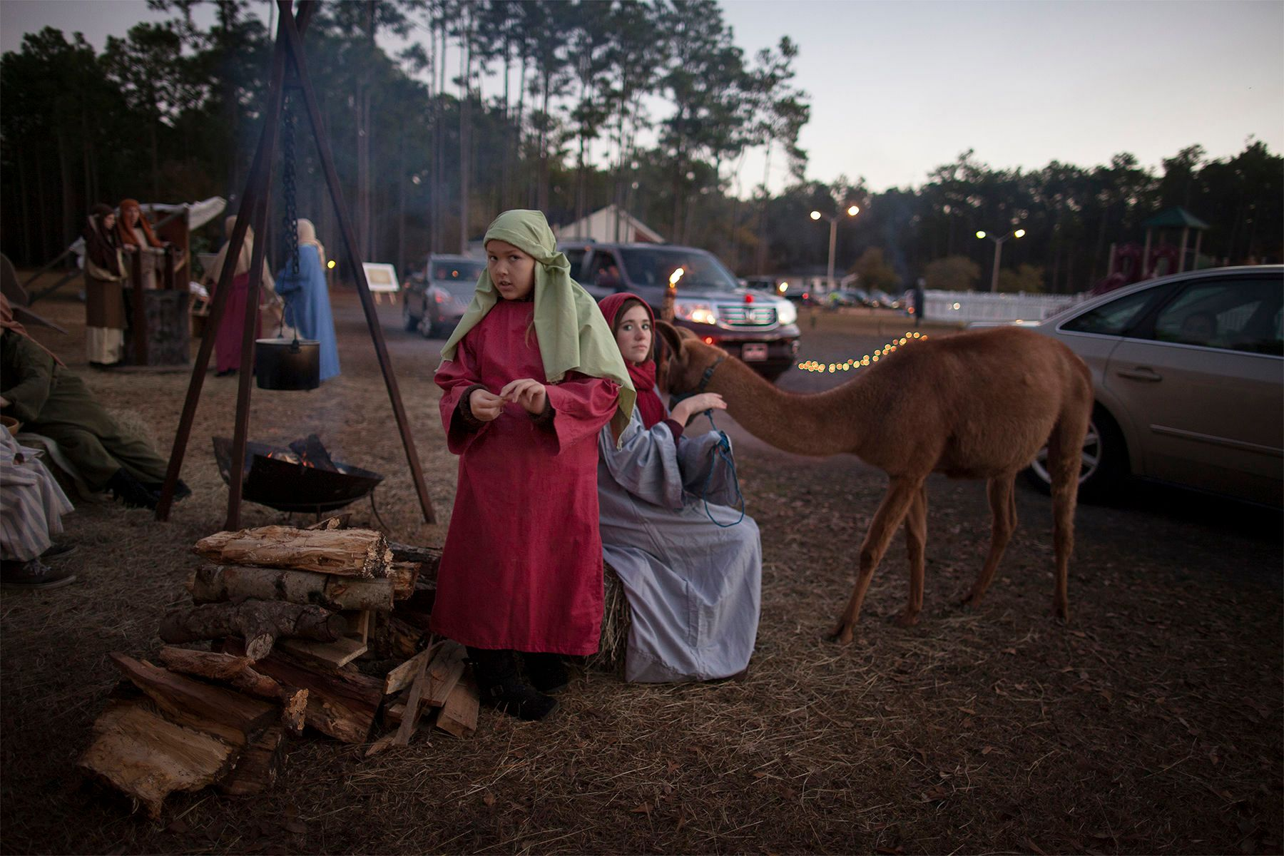Kristina Gray, left, and Tara Hutchinson, perform as villagers at the Bethlehem Inn during The Church of the Resurrection's 3rd annual Return to Bethlehem Drive-Thru Nativity presentation Sunday night in Surfside Beach. About 75 actors, performed by parishioners of the church, told the story of the Nativity in seven stages where viewers could watch from the warmth of their cars. The event was free to the public and included live animals to give the presentation authenticity.