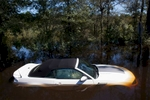 A car that was stranded is submerged in flood waters along Lee's Landing Circle in Conway, South Carolina October 7, 2015. Rescuers searched early Wednesday for two people missing in floodwaters in South Carolina, while authorities urged residents in hundreds of homes to seek higher ground. REUTERS/Randall Hill