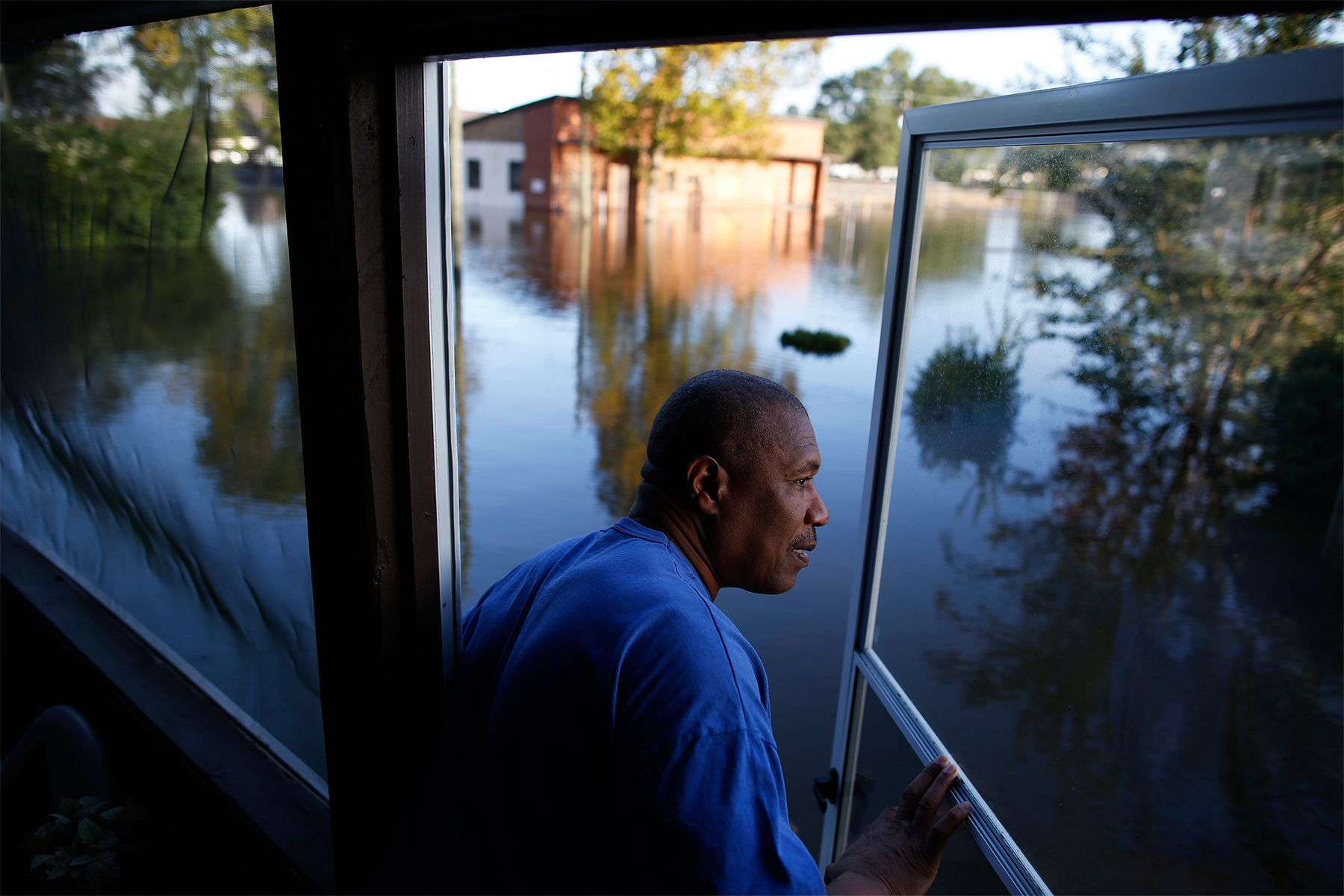 Eric McClary of West Mulberry Lane checks flood levels while checking on his flooded home after the effects of Hurricane Matthew in Goldsboro, North Carolina, U.S., October 12, 2016. REUTERS/Randall Hill