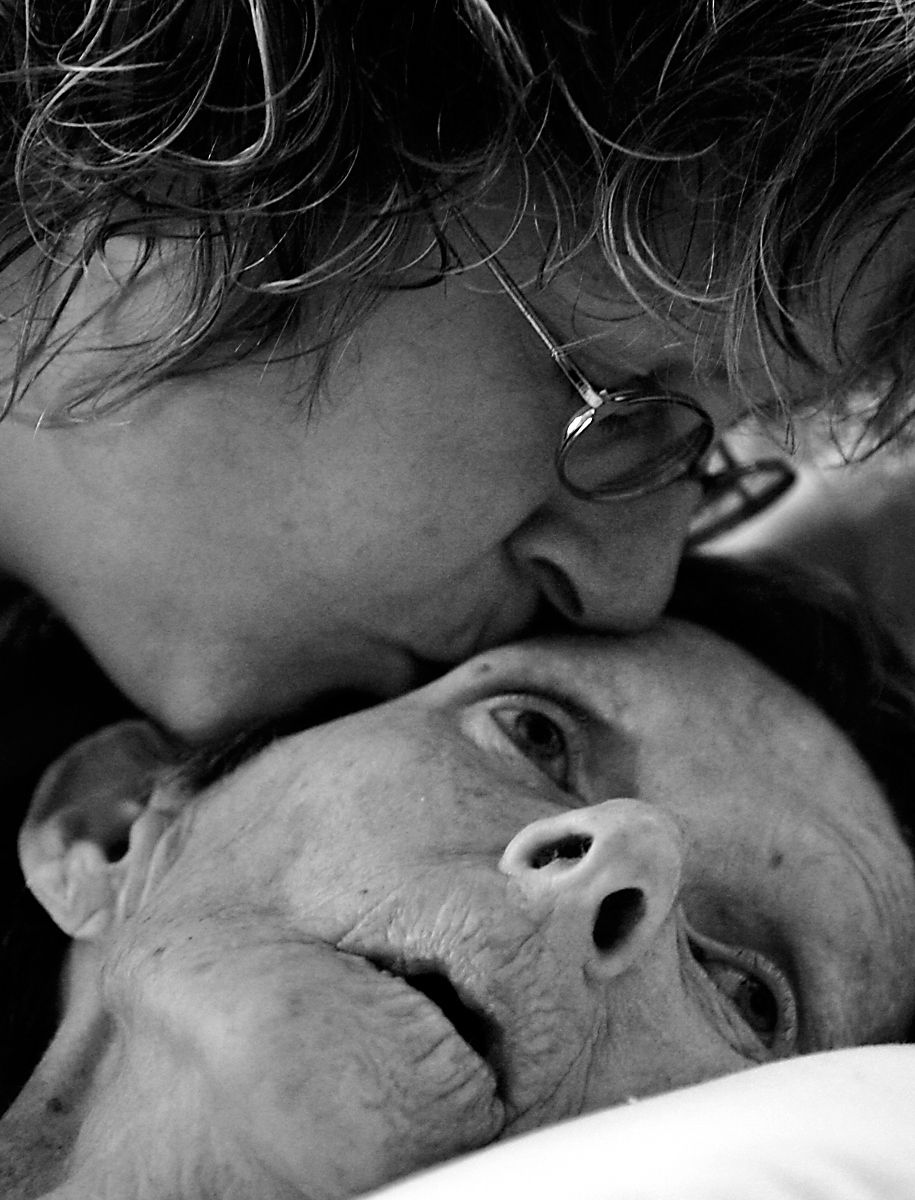 Cassie Jamerson kisses her mother Pat Forister on the afternoon before Forister died of colon cancer at Pat's home in Conway.  A nurse with Mercy Hospice in Conway, Forister reluctantly embraced the dying process and coached her family to celebrate her life with happiness during the final stages of  life.