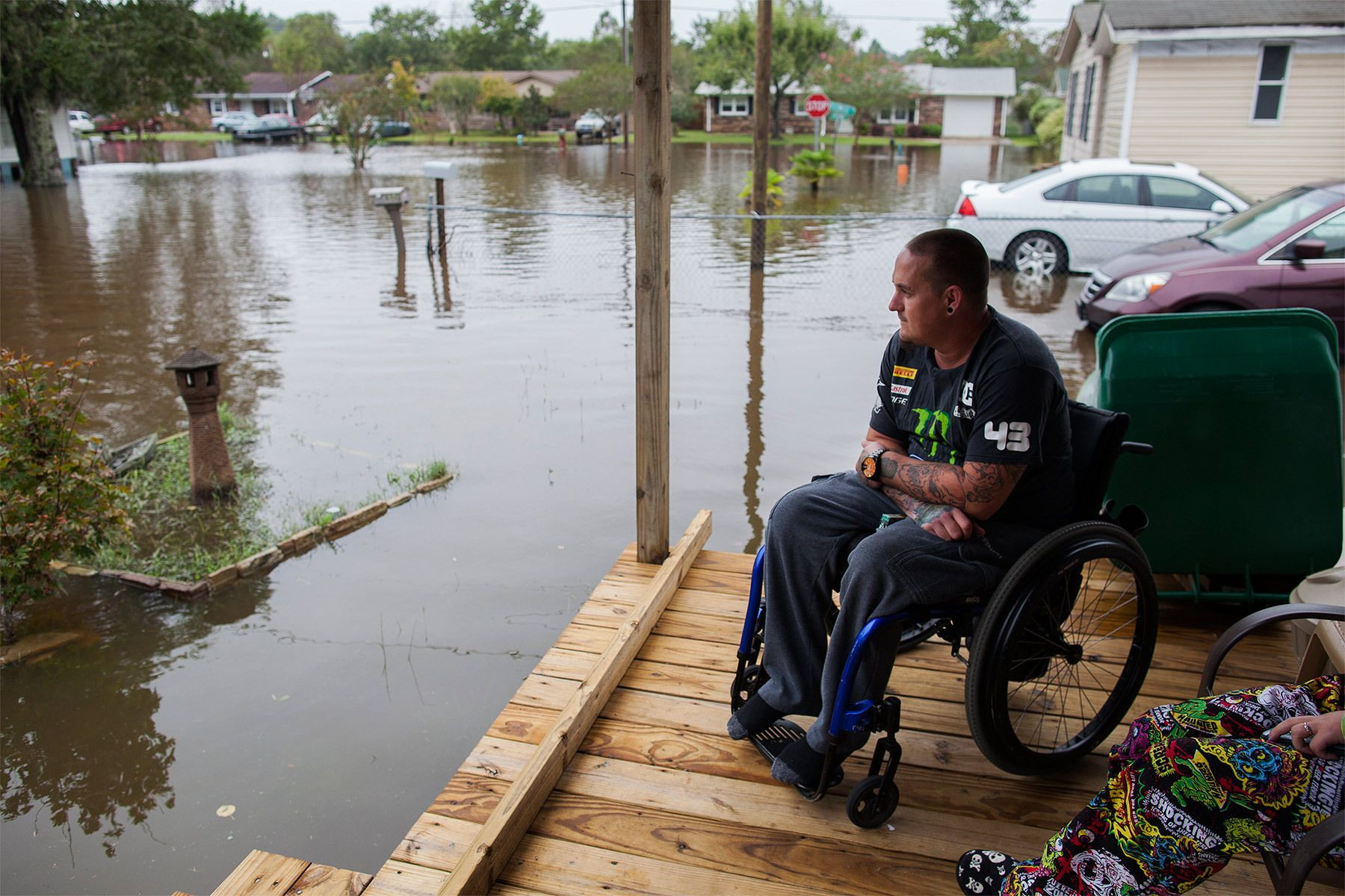 Chris Stubo watches the flood waters that surround his home on Apllewood Court in Myrtle Beach, South Carolina October 5, 2015. Torrential rainfall that South Carolina's governor called a once-in-a-millennium downpour triggered flooding in the southeastern U.S. state on Sunday, causing at least eight deaths in the Carolinas. The storm had dumped more than 20 inches (50 cm) of rain in parts of central South Carolina since Friday, the National Weather Service said. The state climatologist forecast another 2 to 6 inches (5 to 15 cm) through Monday as the rain began to slacken. REUTERS/Randall Hill