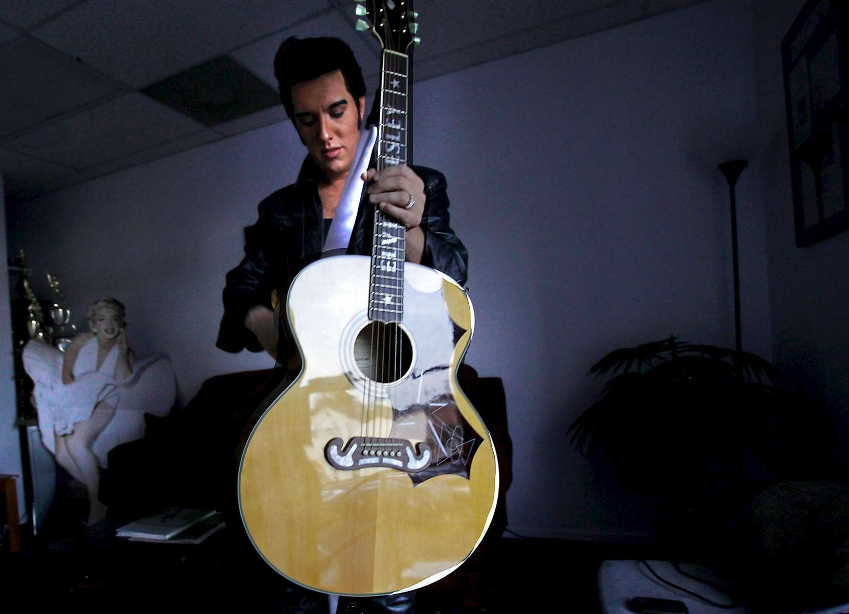 Legends In Concert Elvis tribute artist Nathan Belt prepares for a show in August while waiting in an upstairs meeting room at the Surfside Beach theatre. The McKinney, TX, native became the featured Elvis at the theatre shortly after winning an Ultimate Elvis preliminary contest at the show in 2009. According to a recent survey by Elvis Presley Enterprises, Belt is one of more than 84,000 performers whose principal occupation is paying tribute to the late king of rock.