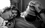 On the day after their mother died, Cassie comforts her brother Mike Snelson while the family make arrangements for Pat's memorial service.