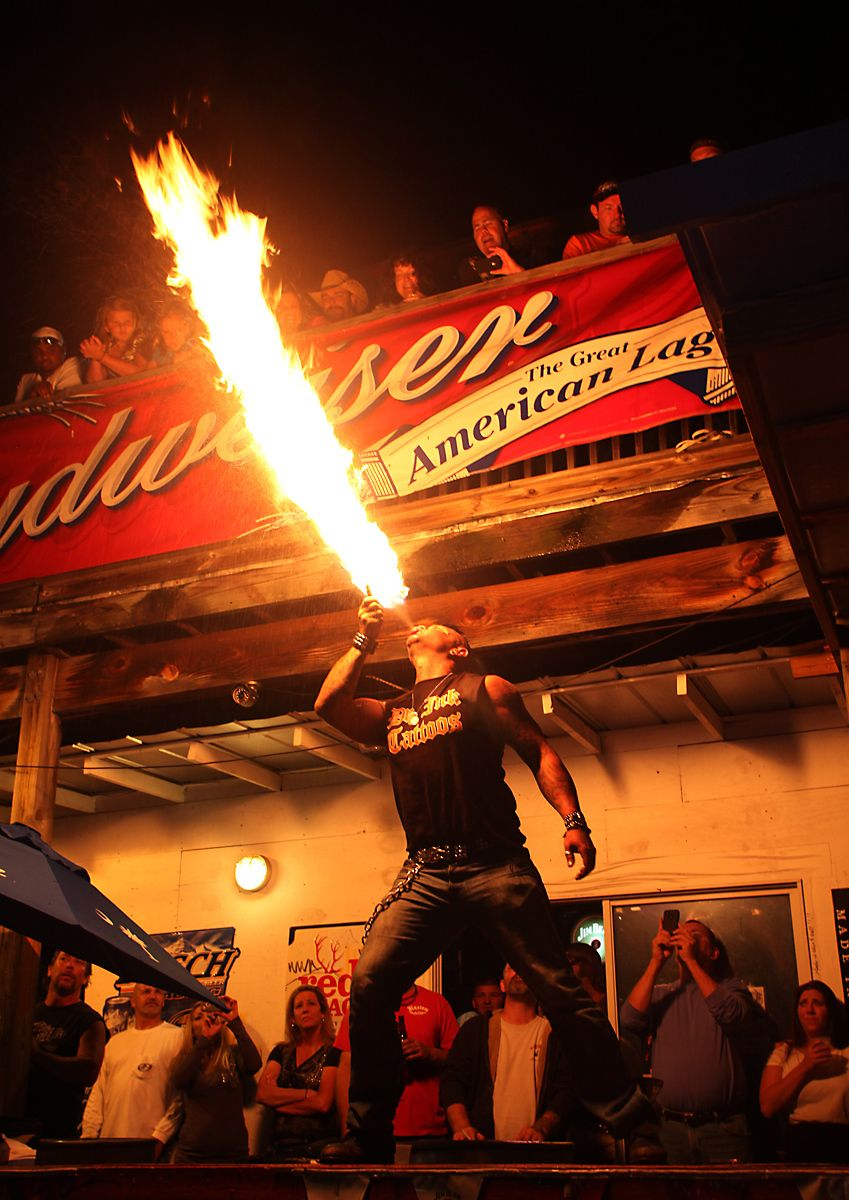 A fire eating performance artist who goes by the name Torch, blows fire from his mouth May 19, 2012 at the biker bar Suck Bang Blow in Murrells Inlet, S.C. The fire eater's show was one of the events scheduled during the annual Harley-Davidson Motorcycle Spring Rally around and in Myrtle Beach, SC. Several motorcycle rallies are annual events in and around the southern resort community of Myrtle Beach. Later this week events starts for the Atlantic Beach Bike Fest in nearby Atlantic Beach. Picture taken May 19, 2012.   REUTERS/Randall Hill