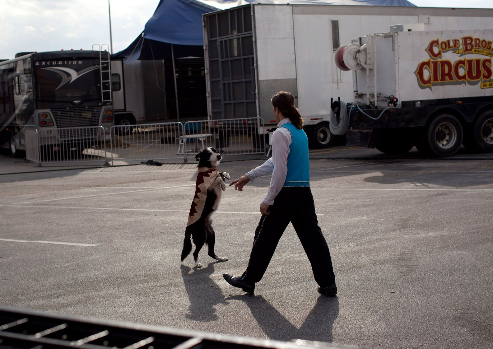 Cole Brothers Circus of the Stars performer German Fassio works with a dog backstage before the start of the first show in Myrtle Beach, South Carolina March 31, 2013. Traveling circuses such as the Cole Brothers Circus of the Stars, complete with it's traveling big top tent, set up their tent city in smaller markets all along the East Coast of the United States as they aim to bring the circus to rural areas. The Cole Brothers Circus, now in its 129th edition, travels to 100 cities in 20-25 states and stages 250 shows a year.   REUTERS/Randall Hill   (UNITED STATES)