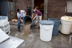 Victor Sanchez (L) and Jose Quino remove flood water from the kitchen area at El Cerro Grande Mexican restaurant in Georgetown, South Carolina October 5, 2015. According to Fernando Morales, the owner of the restaurant, water rose to a level of 4 feet in most areas of the business. Torrential rainfall that South Carolina's governor called a once-in-a-millennium downpour triggered flooding in the southeastern U.S. state on Sunday, causing at least eight deaths in the Carolinas. The storm had dumped more than 20 inches (50 cm) of rain in parts of central South Carolina since Friday, the National Weather Service said. The state climatologist forecast another 2 to 6 inches (5 to 15 cm) through Monday as the rain began to slacken. REUTERS/Randall Hill