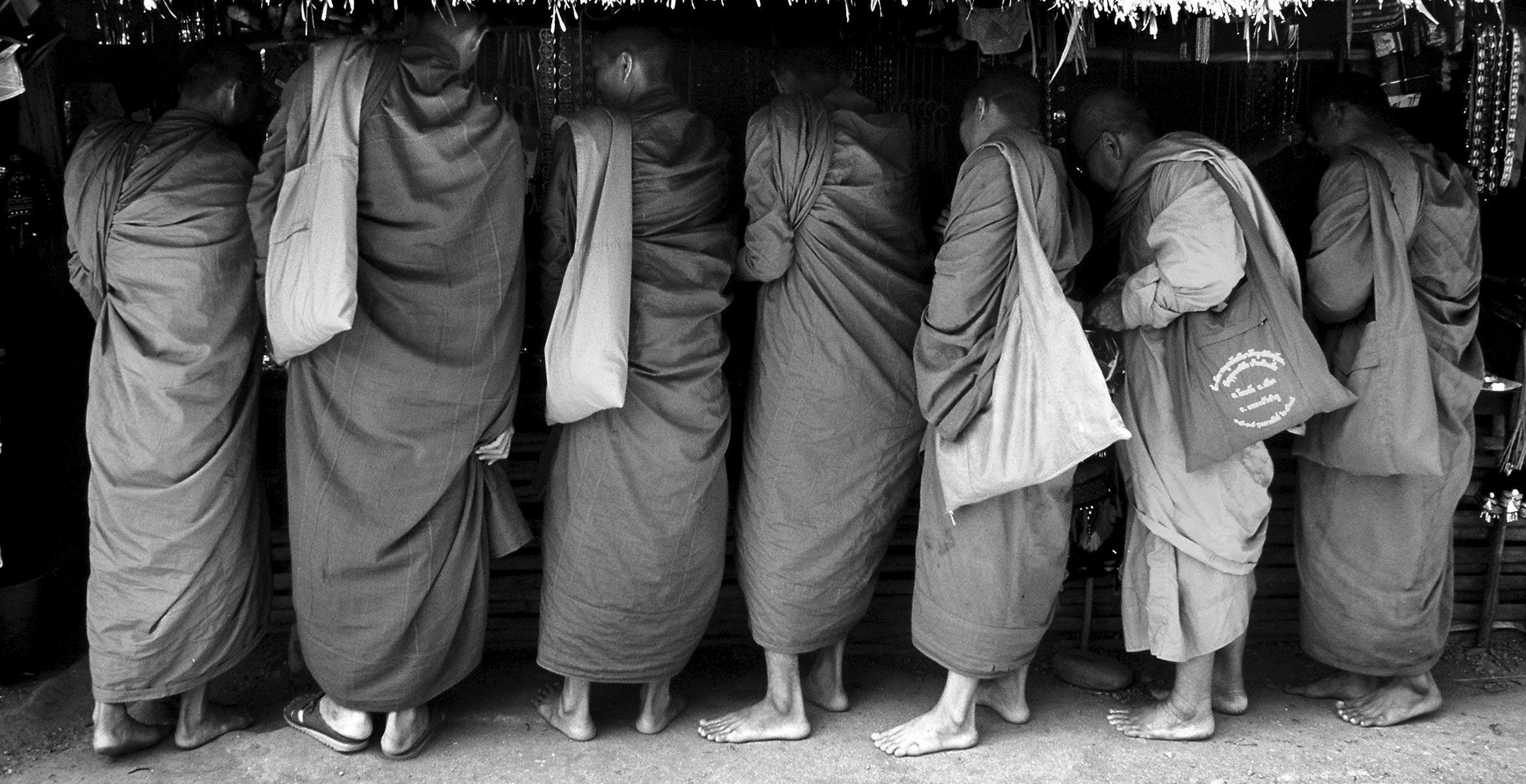 Theravada monks shop at a roadside market near their temple in Maesalong.
