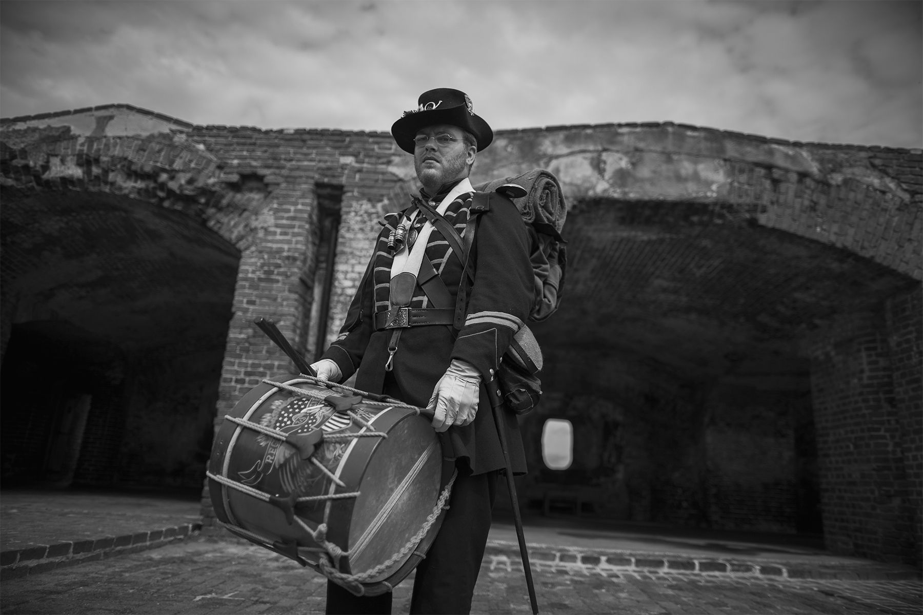 Union soldier reenactor Kelly Ford of Portland, Oregon, prepares to play a drum during a re-enactment ceremony at Fort Sumter National Monument in Charleston, South Carolina April 14, 2015. Civil War re-enactors raised an American flag at the Fort Sumter National Monument during a ceremony on Tuesday commemorating the 150th anniversary of the symbolic end to the four-year conflict in the place where it began.  REUTERS/Randall Hill