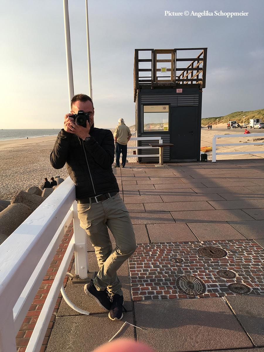 "A look behind the scenes of my personal project ""Family Journeys."" Here, I am photographing my parents on Sylt. Sylt, Germany, May 2018. Picture by Angelika Schoppmeier."