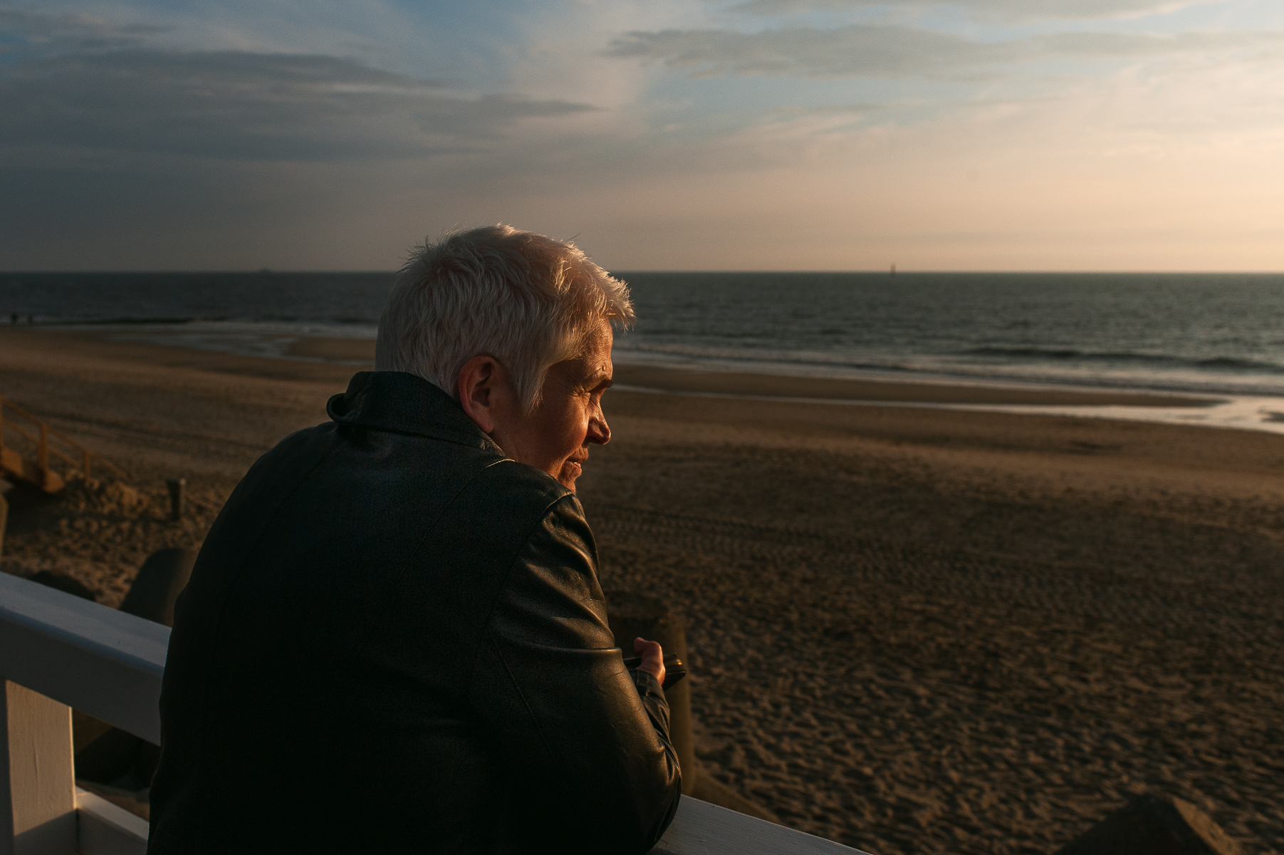 Mom watches the sunset on the promenade in Westerland. Sylt, Germany, June 16, 2018.