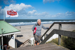 Mom reaches the top of the stairs to the promenade after a beach walk. Domburg, Netherlands, October 10, 2019.