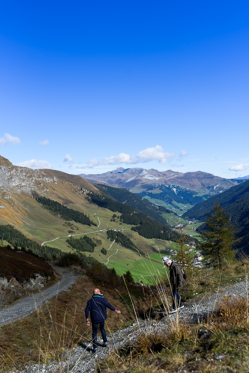 Dad checks on mom as they hike through the Ziller valley mountains in Hintertux. Austria, October 8, 2018.