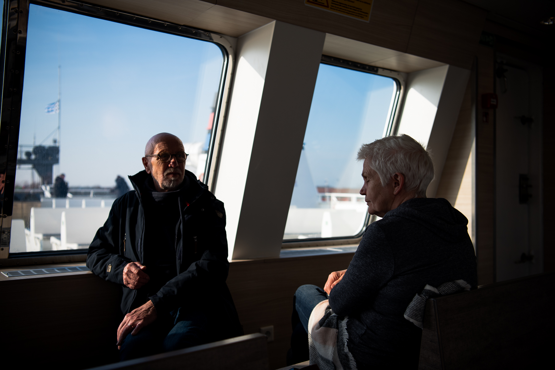After long walks on the island of Norderney, mom and dad wait for the ferry's departure back to the mainland. Here, they sit in the observation area on the upper deck. Norderney, Germany, March 5, 2020.