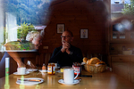 Mom and dad sit down for breakfast at the cottage in Mayrhofen. Austria, October 9, 2018.