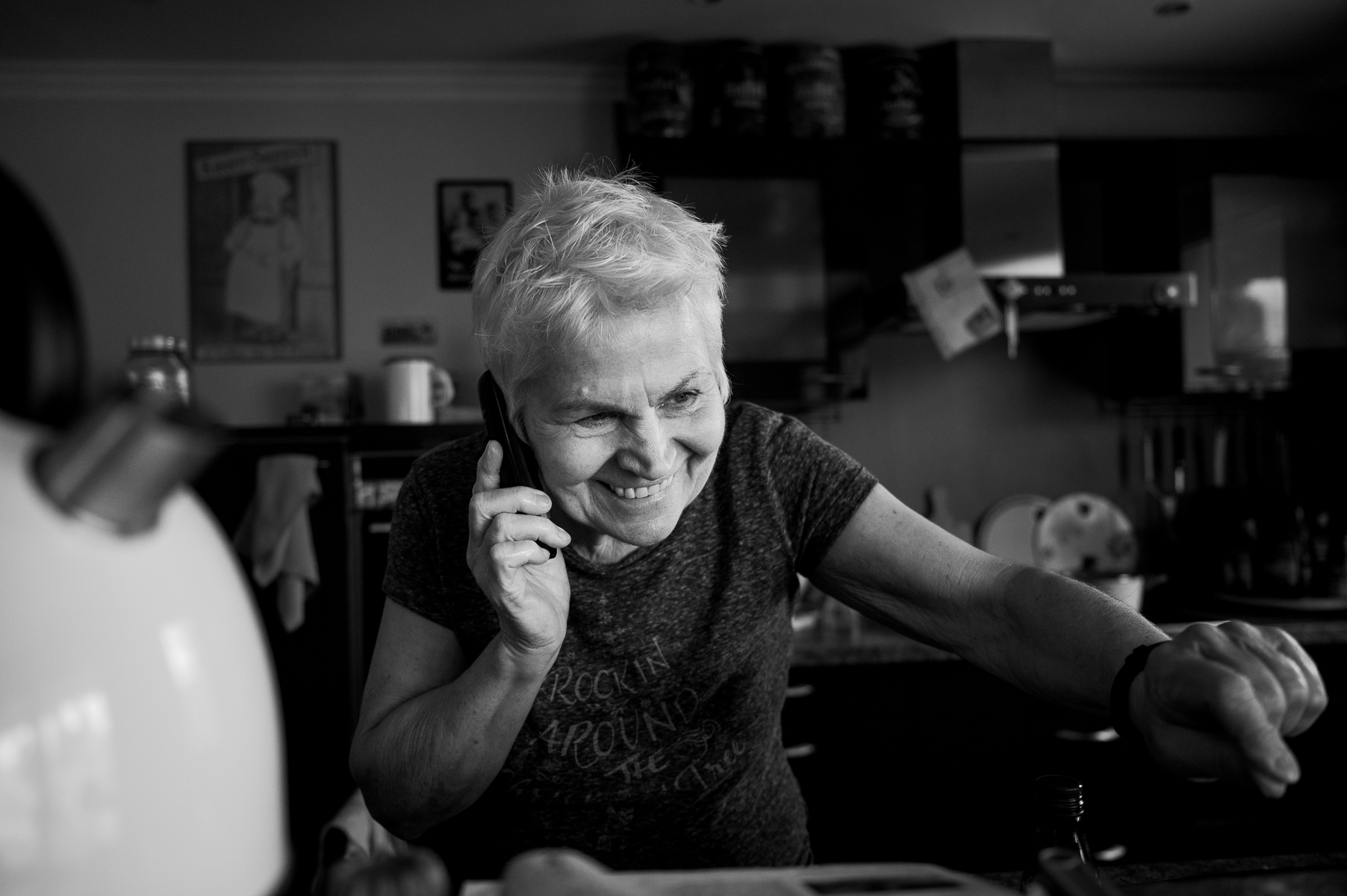 While emptying the dishwasher, mom talks with daughter Ann-Kristin, who lives 75 km away in Cologne, on the phone, an important activity to keep in touch not only but especially during stay-at-home orders. Oberhausen, Germany, March 15, 2020.