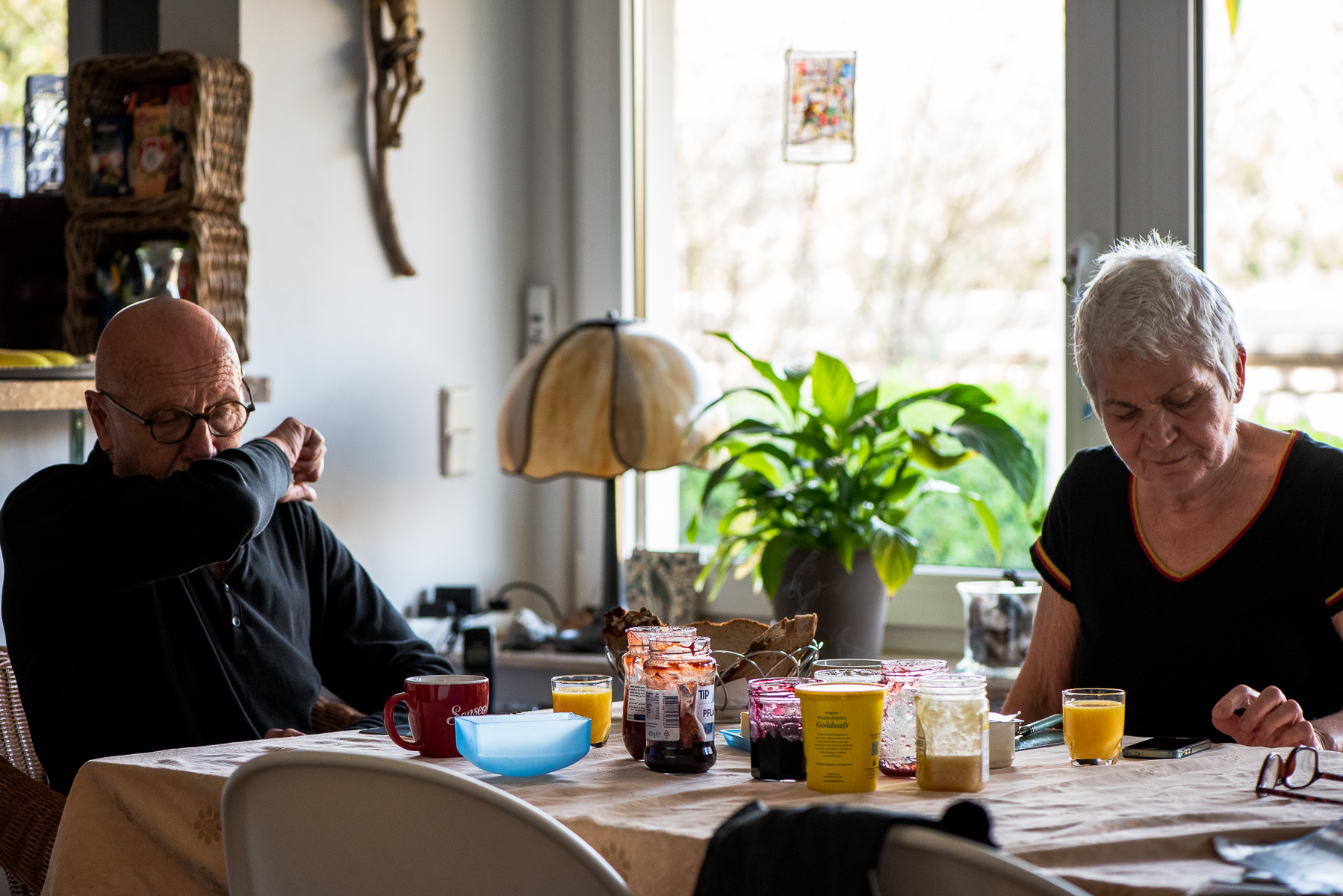 Mom and dad have breakfast at home. Oberhausen, Germany, March 28, 2020