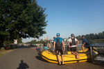 Rafting is less often observed at the white water center in Troja, but on this particular run, I noticed this group in conversation next to their boat. Prague, Czechia, July 25, 2019.