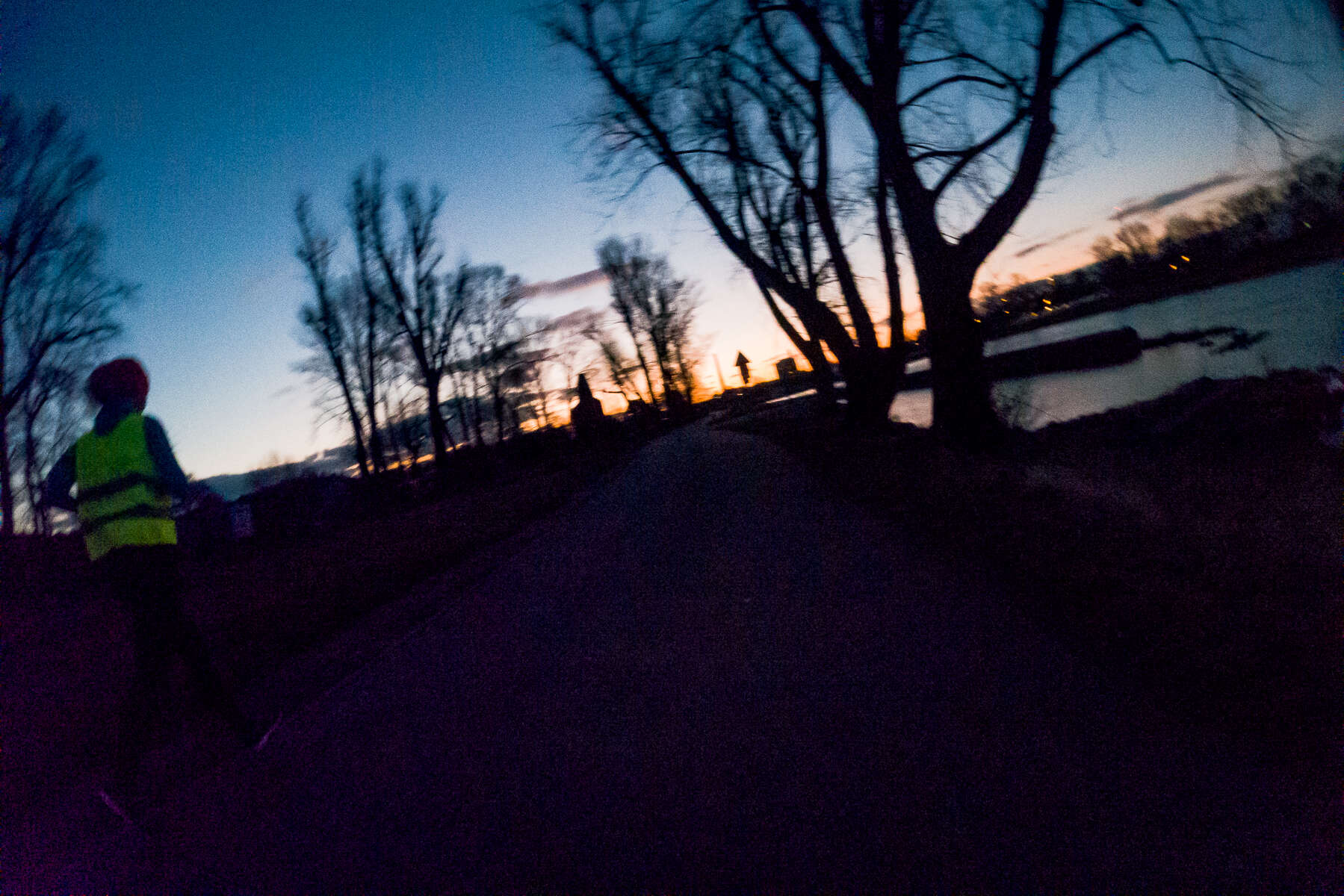 The Vltava riverfront is one of my favorite running spots in Prague. It's almost always free of traffic, and especially in the dawn hours, it's a serene nature retreat without leaving the city. Here, I approach a fellow runner as the sun is beginning to rise on my way back home. Prague, Czechia, February 24, 2020.