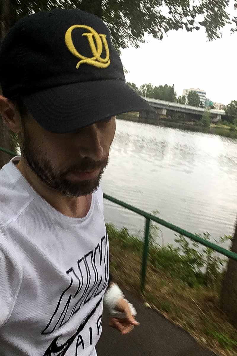 "While I'm not the greatest self-portrait fan on Earth, I'm trying to incorporate that element into my running as well; from time to time. Here, you can see bits of the Vltava and a bandage on my left hand. A reminder on the ""dangers"" of running. I tripped twice in the span of a month, the perks of big city life, I suppose. Prague, Czechia, July 28, 2019."