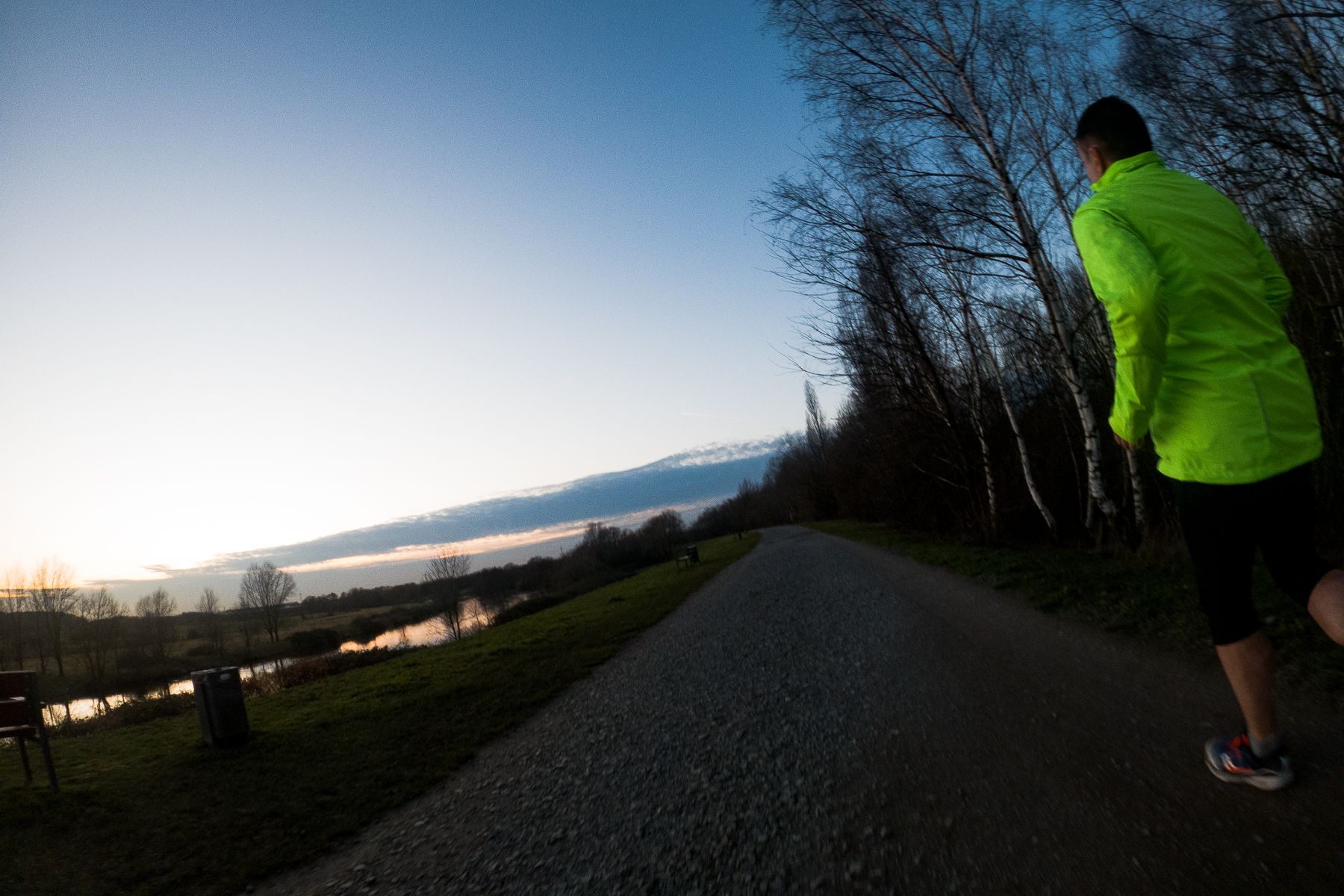 Another solid running location are the Ruhr river wetlands farther north from Mülheim's city center, where the borders between Mülheim and Oberhausen meet. Here, I follow a  path along the river and approach a fellow runner. Oberhausen, February, 19, 2020.