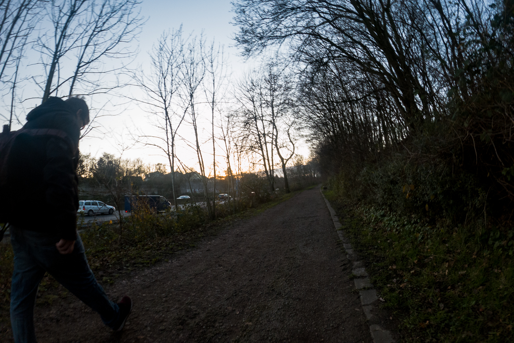 Passing a walker on a short stretch of dirt trail along the autobahn A40 on a newly discovered 10 km route near my parents' home. Mülheim, Germany, December 19, 2019.