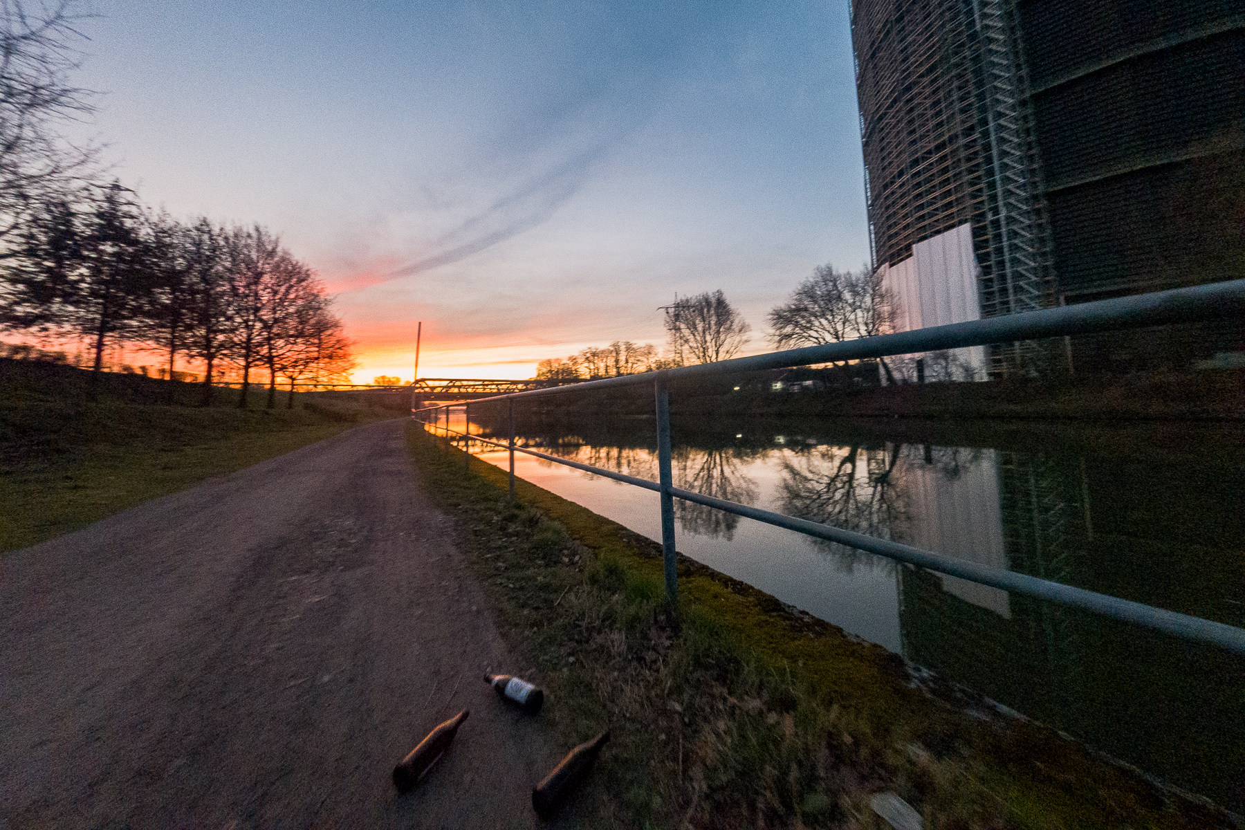 A scene from a sunrise run in the early stages of stay-at-home orders during the COVID-19 pandemic. Pictured here is the lonely canal trail near the Gasometer with empty beer bottles on the ground. Oberhausen, Germany, March 17, 2020.